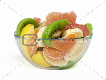 Fruit salad with citrus in a glass bowl