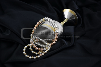 Gold, silver and pearls on a black silk