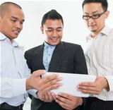 Southeast Asian businessmen discussion
