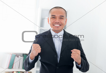 Excited Southeast Asian businessman