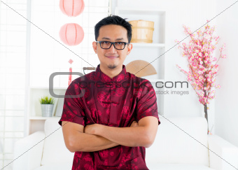 Chinese man standing indoors