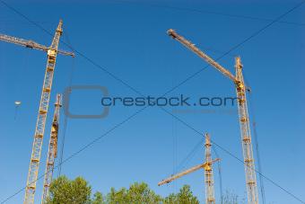 four hoisting cranes