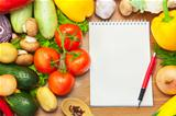 Organic Vegetables on Wooden Background and Notebook