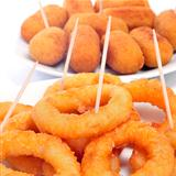 spanish calamares a la romana, squid rings breaded and fried, and croquettes