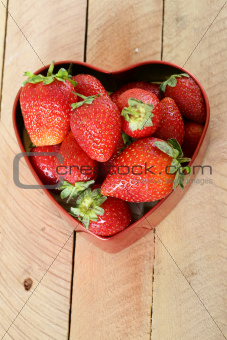 fresh strawberries in a heart shaped box