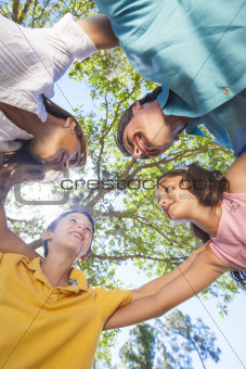 Family Huddle Together Outside In Sunshine