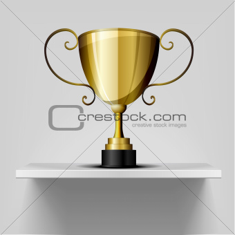 gold trophy on a shelf