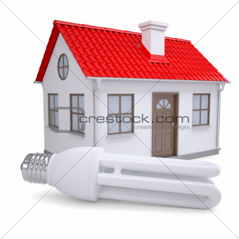 Energy saving lamp on the background of a small house