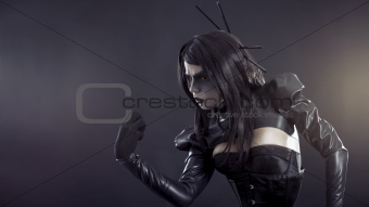 Angry witch in black latex clothes
