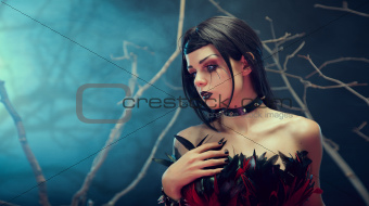 Attractive gothic girl in spiked choker