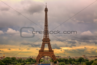 Eiffel Tower under cloudy sky. Paris, France.