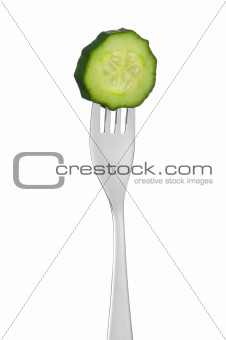cucumber slice on a fork isolated