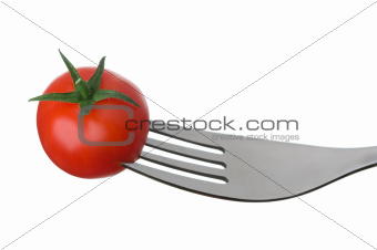 tomato on a fork on white