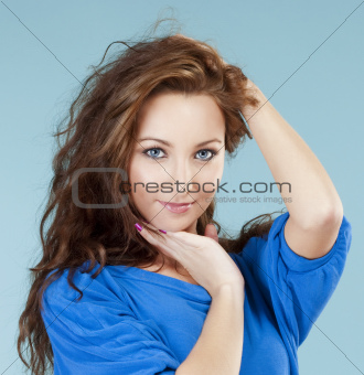 portrait of a young beautiful woman with brown hair and blue eyes