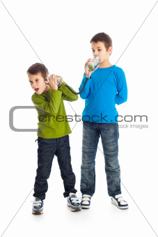 Two boys calling tin can phone.