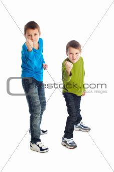 Two boys in a fighting stance.