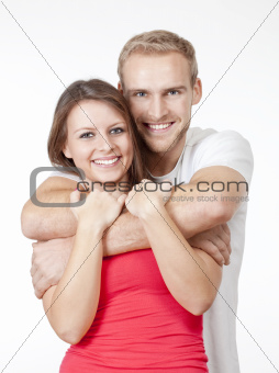 portrait of a happy young couple smiling, looking - isolated on white