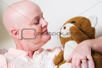 Cancer Patient Comforted by Teddy Bear