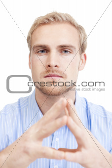 young man sitting thinking, contemplating - isolated on white