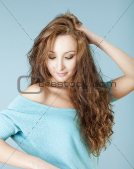 portrait of a young beautiful woman with brown hair looking down
