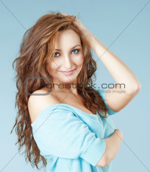 portrait of a young beautiful woman with brown hair and blue eyes smiling