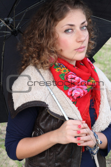 Beautiful curly hair woman with an umbrella