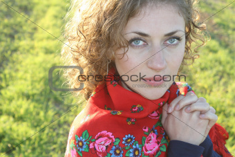 Beautiful curly woman at the fields