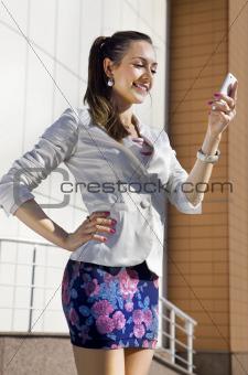 girl holds telephone