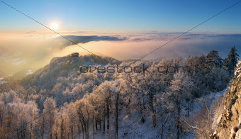 Sunset over clouds in mountain