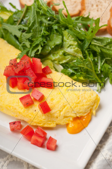 cheese ometette with tomato and salad