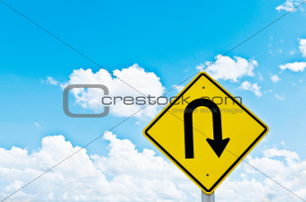 u-turn symbol and blue sky