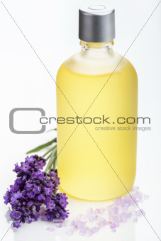 essential oil and lavender flowers over white