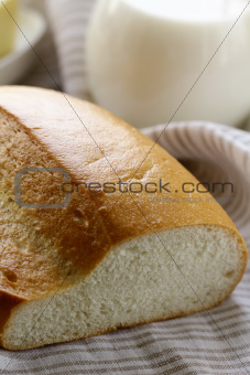 fresh white loaf of bread, rustic style