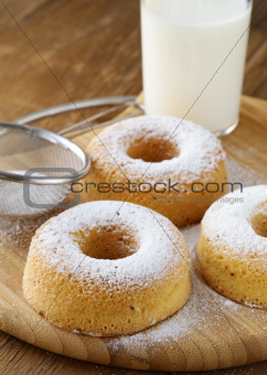 Fresh donuts sprinkled with powdered sugar