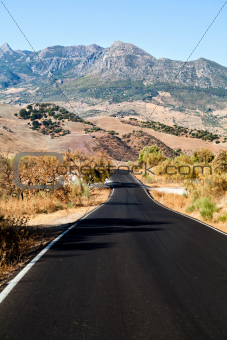 asphalt road to Andalusian mountains