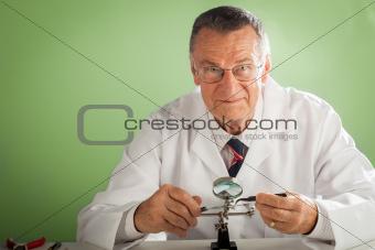 Senior Technician on Green Background