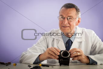 Smiling Man Fixing Camera