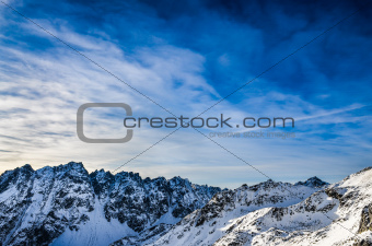 Winter High Tatras mountains landscape with blue cloudy sky