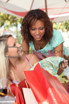 Friends in a cafe with shopping bags
