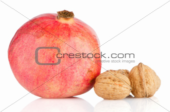 Ripe pomegranate fruit and nuts