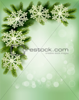 Christmas retro background with christmas tree branches and snowflakes.