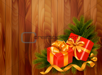 Holiday retro background with christmas tree branches and gift boxes. Vector.