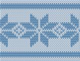 seamless knitted pattern with blue snowflakes