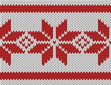 seamless knitted pattern with red snowflakes.