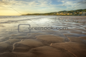 Low point of view along beach at sunset with excellent detail in sand texture