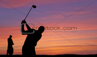 Golfer silhouette against colorful sunset sky