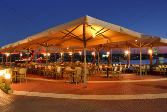 Outdoor restaurant at sunset.
