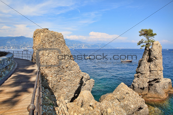 Wooden footbridge along Mediterranean sea coast in Portofino.