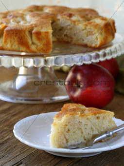 homemade apple pie on a wooden table