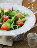 salad mix with avocado tomato and cucumber